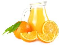 Orange juice with orange and green leaf isolated on white background. juice in jug Royalty Free Stock Photography