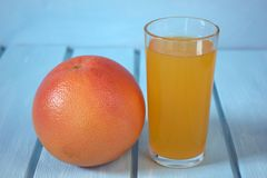 Orange and juice. Vitamin on a blue background Royalty Free Stock Photo