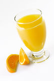 Orange Juice with Orange Slices. Glass of orange juice with garnish on light background stock photo