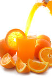 Orange juice and oranges Stock Images