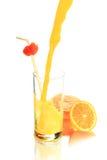 Orange juice and oranges Stock Images