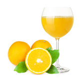 Orange juice and oranges Stock Image