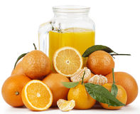 Orange Juice and Oranges Stock Photography