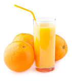 Orange juice and oranges Royalty Free Stock Images