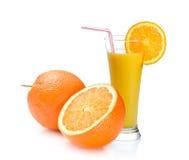 Orange juice and oranges Stock Photos