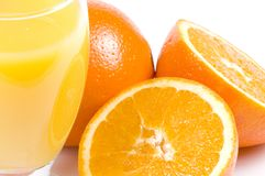 Orange juice and oranges. A close-up picture of orange juice and oranges stock photography