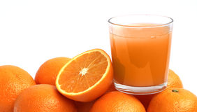 Orange juice and oranges Royalty Free Stock Image