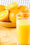 Orange juice with oranges Stock Images