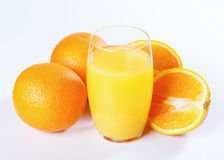 Orange juice and oranges Stock Photography