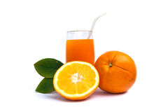 Orange juice and oranges with leaves Stock Photo