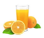 Orange juice and oranges with leaves Royalty Free Stock Images