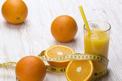 Orange juice, oranges and measuring tape Stock Images