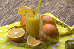 Orange juice, oranges and measuring tape Stock Photo