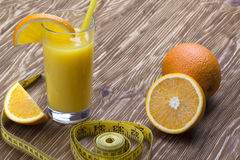 Orange juice, oranges and measuring tape Stock Image