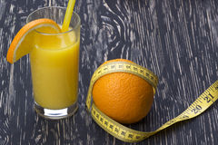 Orange juice, oranges and measuring tape Stock Photography