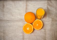 Orange juice and oranges. Top view with copy space. Royalty Free Stock Images