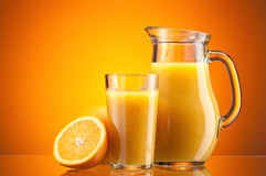 Orange juice over orange Royalty Free Stock Image