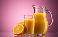 Orange juice over pink Stock Image
