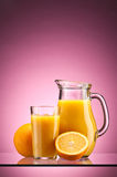 Orange juice over pink Royalty Free Stock Image