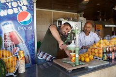 Orange juice. Palestinian man is make the orange juice at the bar on the mount of Temptation, Jericho,Palestune,Israel Royalty Free Stock Photo