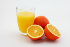 Orange juice. The picture is a glass of orange juice and fresh oranges royalty free stock photos