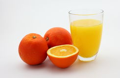 Orange juice. The picture is a glass of orange juice and fresh oranges stock images