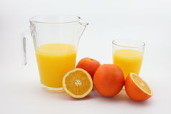 Orange juice. The picture is a pot of orange juice and fresh oranges royalty free stock images