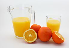 Orange juice. The picture is a pot of orange juice and fresh oranges royalty free stock photography