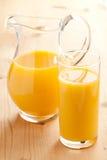 Orange juice in pitcher Stock Photos