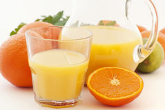 Orange Juice with Pitcher. And fresh oranges Stock Images
