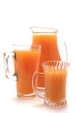 Orange juice pitcher and glasses. Orange juice pitcher and two glasses Stock Image