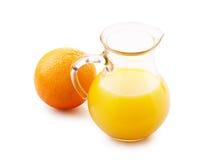 Orange juice in pitcher and orange Royalty Free Stock Photos