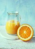 Orange juice in a pitcher Stock Photos