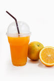 Orange juice in plastic clear cup and orange fruit Stock Image