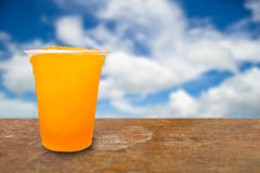 Orange juice in plastic cups Stock Photo