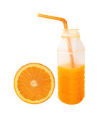 Orange juice in plastic half bottle Slice orange isolated on whi Royalty Free Stock Image