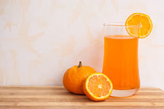Orange juice on plywood background Royalty Free Stock Photography