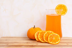 Orange juice on plywood background Stock Images