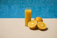 Orange juice at the poolside Stock Photo