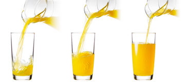 Orange juice poured into a glass Stock Photo