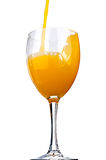 Orange juice poured into a wine glass Royalty Free Stock Images