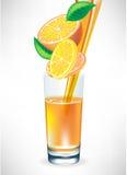 Orange juice pouring in glass Stock Photo
