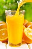 Orange juice. Pouring into glass Stock Photo