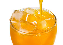 Orange juice pouring into glass Royalty Free Stock Images