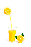 Orange juice pouring into glass with orange slice and leaf, isol Royalty Free Stock Photos