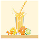 Orange juice pouring into a glass Royalty Free Stock Images