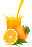 Orange juice pouring into a glass with splash. Royalty Free Stock Photography