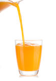 Orange juice pouring into glass Stock Photo