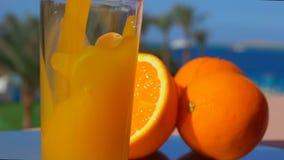 Close-up orange juice poured into a glass stock footage