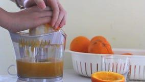 Orange juice preparation stock footage